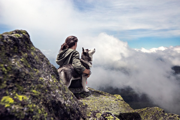 husky-and-owner-hiking